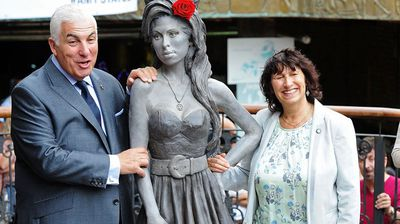 """""""It is like stopping her in a beautiful moment in time,"""" said the singer's father Mitch Winehouse (pictured with his wife Janis), who said seeing the statue was """"incredibly emotional"""". (Getty)"""