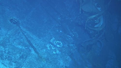 Remotely operated cameras snapped a picture of the number '35' painted on the hull of the USS Indianapolis. (AAP)