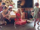 Family opening Christmas gifts together.