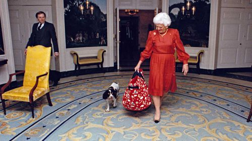 Barbara Bush in the White House with her dog Millie in 1989. (AAP)