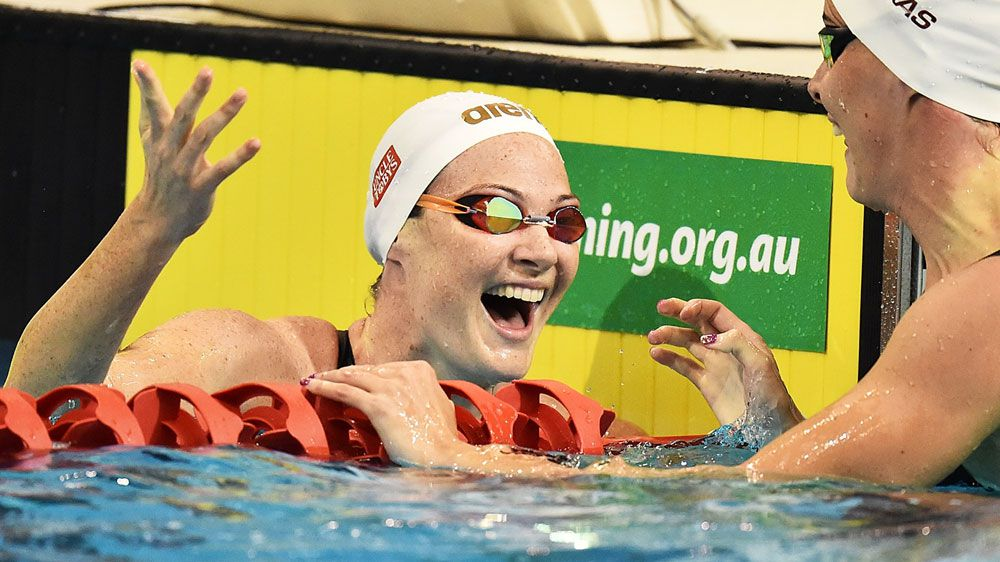 Cate Campbell reacts alongside her sister Bronte after their semi final. (Getty)