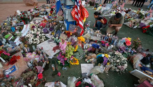 People visit a makeshift memorial for victims of the mass shooting in Las Vegas. (AP)