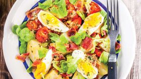 Potato salad with bacon and boiled eggs