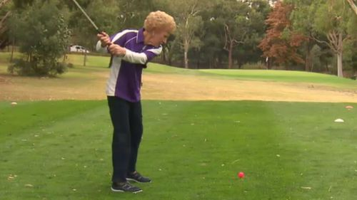 Ms Willcox shows off her swing. (9NEWS)