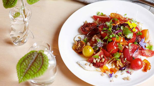 Tomato, fried wheat and goat's curd salad
