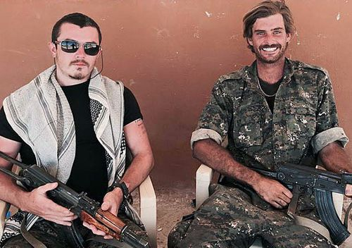 Queensland man Ashley Dyball (left), poses for a photograph with Reece Harding, who was killed fighting alongside Kurdish forces in Syria. (AAP)