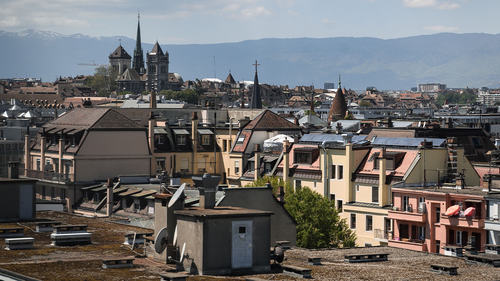 This picture taken on May 13, 2019 shows the St. Pierre Cathedral overlooking the roofs in the center of Geneva. (Photo by Fabrice COFFRINI / AFP)