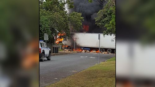 The stolen truck on fire, after it ploughed through the main road of Singleton.