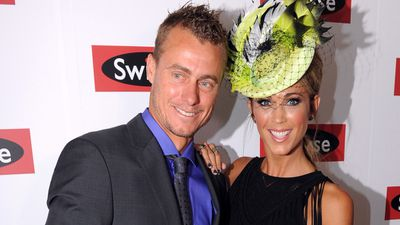 Lleyton and Bec Hewitt turn up for the race. (AAP)