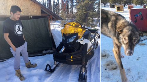 Nulato resident Arnold Demoski, 26, and one of the dogs he injured. (KTUU)