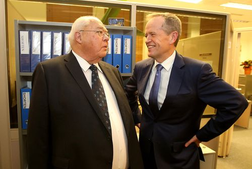 Laurie Oakes and Opposition leader Bill Shorten share a story at Laurie's farewell drinks.