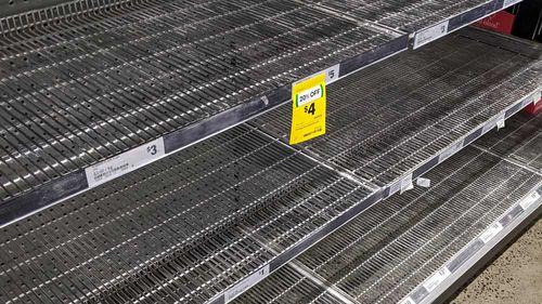 Empty supermarket shelves with coronavirus panic buying