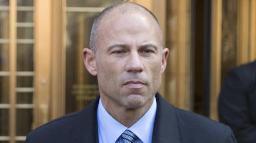 Michael Avenatti listens outside federal court, Monday, April 16, 2018, in New York. (AP Photo/Mary Altaffer)