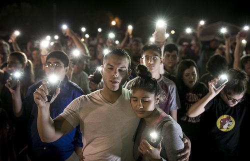 Matthew Mata and Erika Gonzalez participate in a memorial service for the victims of the church shooting in Texas. (AAP)