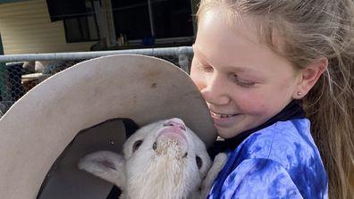 Lydia cuddles lamb