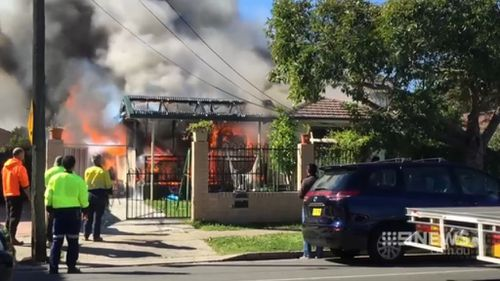 Fire destroyed a family home in Auburn, Sydney, today. (9NEWS)