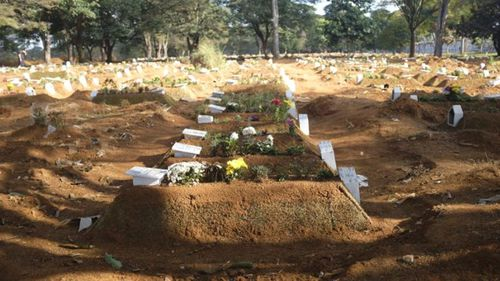 Recently dug graves in the Vila Formosa cemetery.