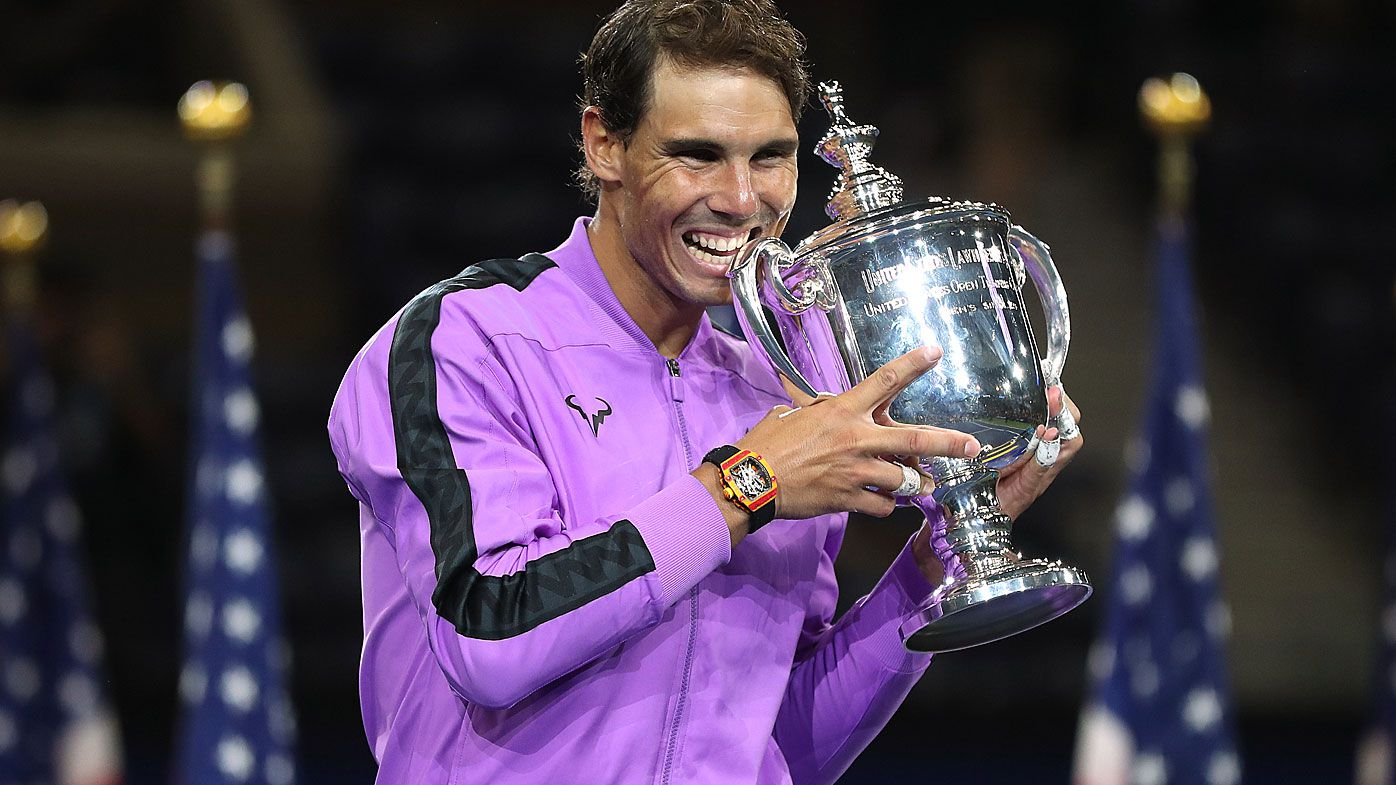 Rafael Nadal of Spain celebrates with the championship trophy during the trophy presentation ceremony