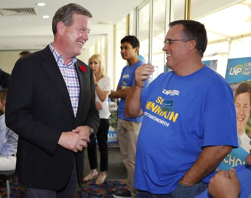 Queensland Opposition leader Tim Nicholls talks to a local resident at the campaign launch of Steve Minnikin, candidate for Chastworth. (AAP)