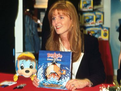 The Duchess of York holds one of her Budgie books.
