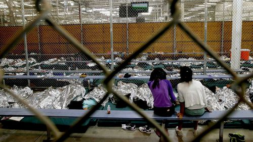 Photos show young children sprawled on mattresses on cold floors, with only silver space blankets for protection and comfort. (AP)