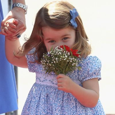 Princess Charlotte sniffs her flowers, July 2017