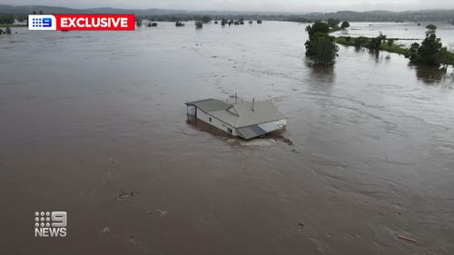 Sarah and Joshua Edge's home swept away in the NSW floods.