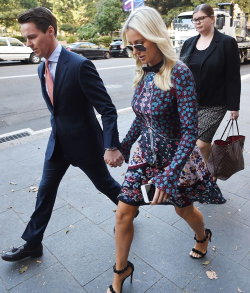 Stockbroker Oliver Curtis arrives with wife Roxy Jacenko at the Supreme Court of New South Wales during his trial in May.