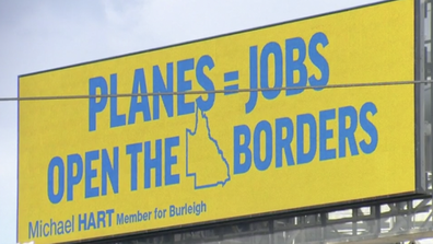 The billboard has been placed alongside a busy Gold Coast intersection.