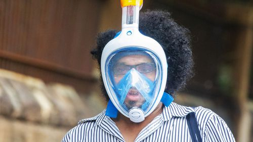 A person wearing a snorkel and mask is seen on March 26, 2020 in Sydney