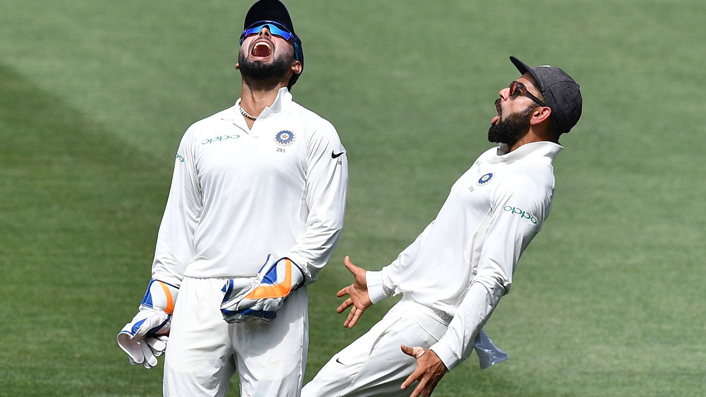 Pant and Kohli celebrate a wicket