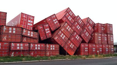 Winds blew over 30 sea containers at Rous Head, weighing 4 tonne each. (9NEWS)