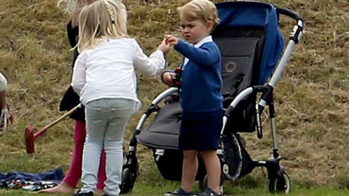 The prince wandered around with a toy car and played with other kids at the event. (AAP)