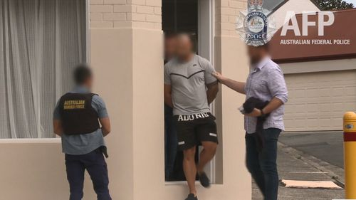 Two men were arrested by police in Sydney and Brisbane yesterday and will face court today.