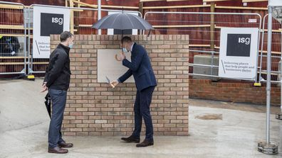 Prince William, Duke of Cambridge looks at a plaque to mark the construction of the groundbreaking Oak cancer centre at Royal Marsden Hospital on October 21, 2020 in Sutton, Greater London.