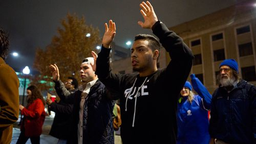 David Garcia holds his hands up during a protest in Lincoln, Nebraska. (AAP)