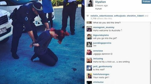 Lily Allen posted a photo on Twitter of her apparently being 'cuffed' by AFP officers on the Gold Coast.