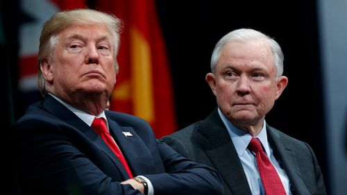 President Donald Trump sits with Attorney General Jeff Sessions during the FBI National Academy graduation ceremony in Quantico, Virginia in December 2017. (AAP)