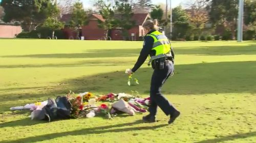 A police officer was seen laying a rose for Ms Dixon. (9NEWS)