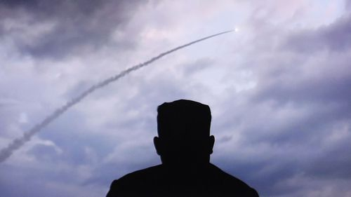 Kim Jong-un watches a missile being launched.