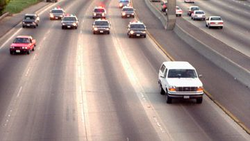 A white Ford Bronco, driven by Al Cowlings and carrying O.J. Simpson, is trailed by police cars as it travels on a southern California freeway on June 17, 1994, in Los Angeles