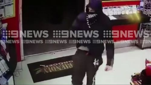 A Queensland shop owner has fought off this masked man during an attemped robbery overnight. Picture: Supplied.