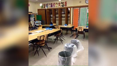 """Another classroom catching water from leaking roofs."" (Twitter/@teachdetroit)"
