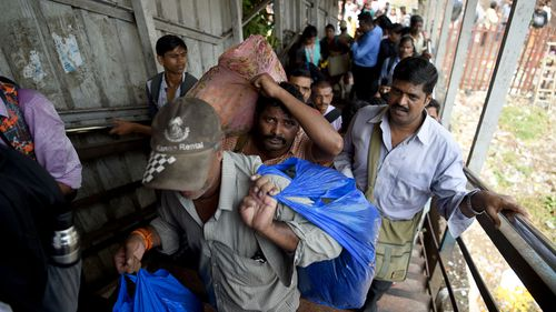 Stampede at Indian train station kills at least 22