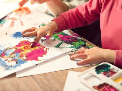 Child finger painting