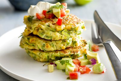 Crispy corn and zucchini fritters with tomato and avocado salsa
