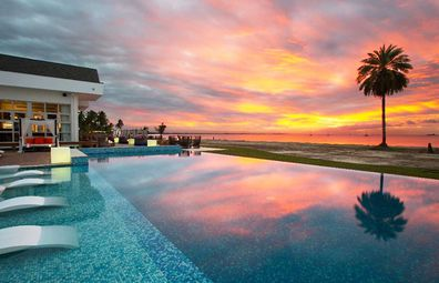 Pool at Pullman Resort & Spa Fiji, sunset