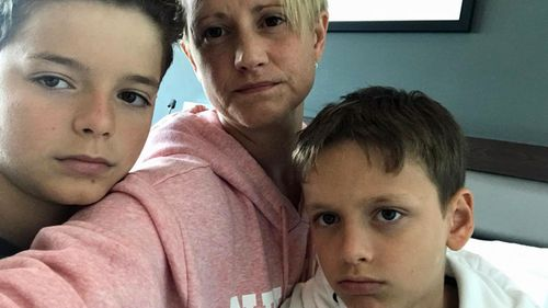 Sarah Greig and her sons have been forced into isolation at the Novotel in Brisbane.