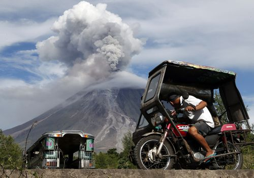 A Filipino villager looks on as Mayon Volcano erupts anew in Legaspi city, Albay province, Philippines in January 2018.