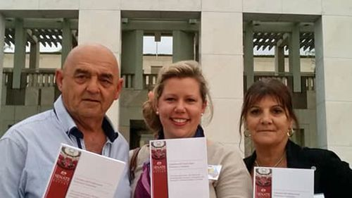 Lana Cormie pictured with Jack Brownlee's parents David and Janine outside Parliament House after the senate inquiry released its final report into workplace deaths last month.